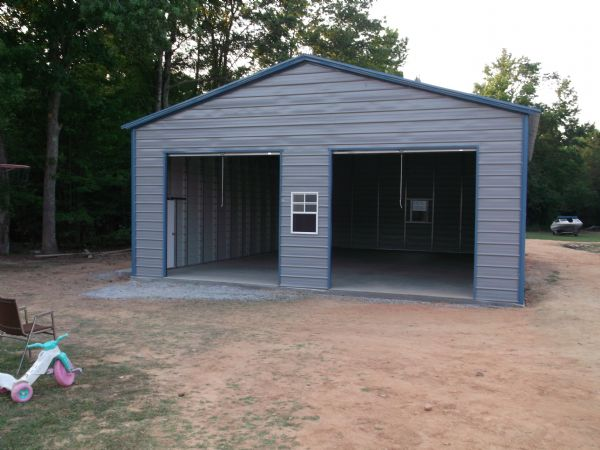 A Frame garage with two roll up doors, one walkin door, two windows Item # 73