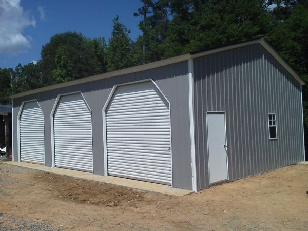 A Frame Fully Verticle Sidewinder Garage with 3 rollup doors with dutch cuts, walkin door and 2 windows Item #42