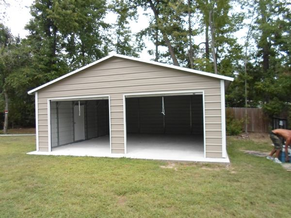 A Frame Garage with two roll up doors, and one 36