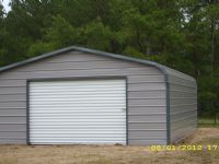 Bent Bow Garage with one roll up door Item # 53