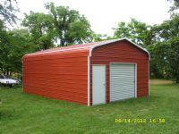 Bent Bow Garage with one roll up door and one 36